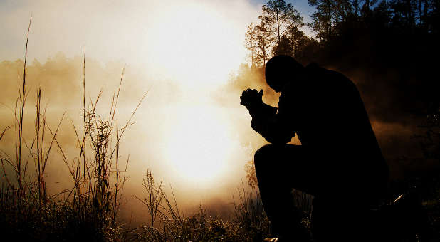 prayer-man-kneeling-outside-sunlight-creativeswap